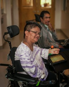 Participant in a mobility device participating in the Improvising with iPads project.