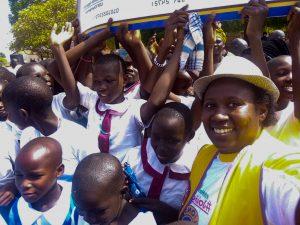 Allen Tush Naturinda with children in Uganda