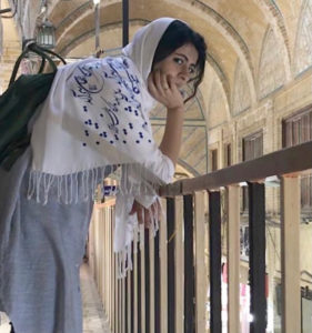 colour photo of a woman leaning on a railing