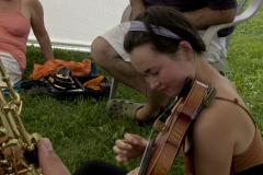 MILE camper playing violin.